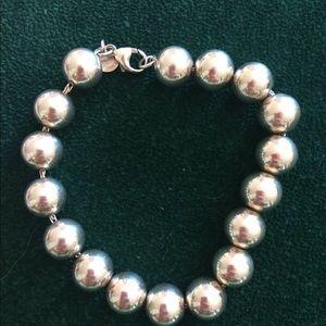 Stealing Silver Bead Tiffany & CO Bracelet.